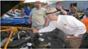 Roush Greets People at Ford Dealership (The Daily Home)